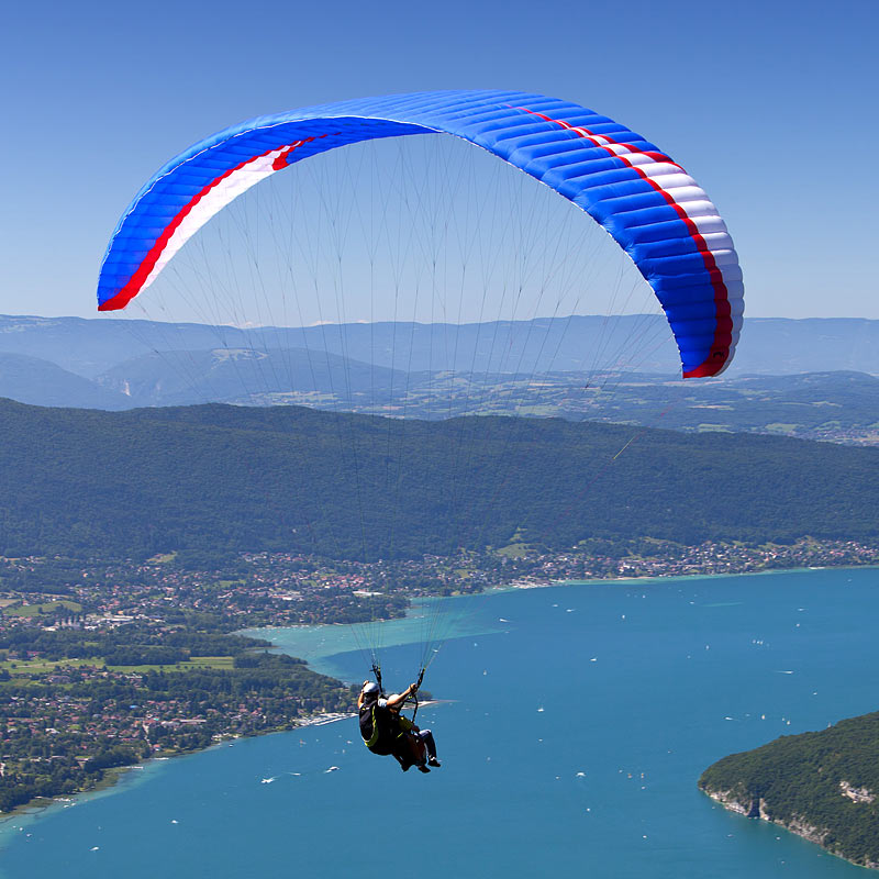 Aerial photograph of a paraglider over the Alps
